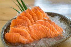 Raw salmon slice or salmon sashimi in Japanese style fresh serve. On ice in bowl at Japanese restaurent Royalty Free Stock Photo