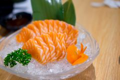 Raw salmon slice or salmon sashimi. In Japanese style fresh serve on ice in bowl Stock Photography
