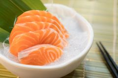 Raw salmon slice or salmon sashimi in Japanese style fresh serve. On ice in bowl Royalty Free Stock Image