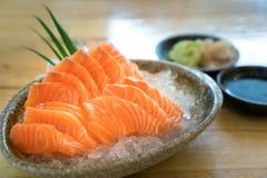 Raw salmon slice or salmon sashimi in Japanese style fresh serve. On ice in bowl Royalty Free Stock Image