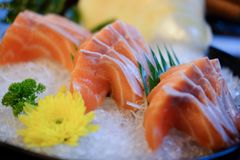 Raw salmon slice or salmon sashimi. In Japanese style fresh serve on ice in bowl Stock Photo