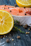 Raw salmon and spices and lemon Royalty Free Stock Images