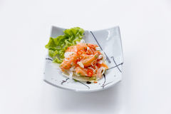 Raw Salmon Spicy Salad in Japanese Painted Ceramic Dish royalty free stock images