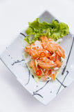 Raw Salmon Spicy Salad in Japanese Painted Ceramic Dish.  Royalty Free Stock Photos