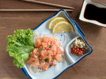 Raw salmon spicy salad. Top view of Raw salmon spicy salad Stock Image