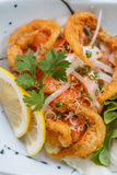 Raw Salmon Spicy Salad Topping with Shirauo Japanese anchovy Tempura.  Stock Photo