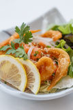 Raw Salmon Spicy Salad Topping with Shirauo Japanese anchovy Tempura.  Stock Image
