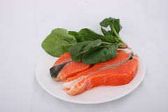 Raw salmon and spinach stock image