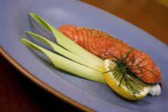 Raw salmon steak. 4. Raw salmon steak with leek and lemon Royalty Free Stock Image
