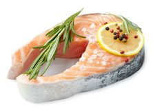 Raw salmon steak, appetite fish. With seasoning on a white background Royalty Free Stock Photo