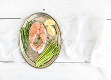 Raw salmon steak with asparagus, lemon, spices and Royalty Free Stock Photography