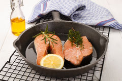 Raw salmon steak in a cast iron pan Stock Photo