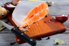 Raw Salmon steak on a cutting board. Cooking concept Stock Images