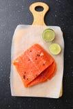 Raw salmon steak on cutting board. Cooking, recipe concept Stock Photos