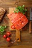 Raw salmon steak on cutting board. Food top view Stock Image