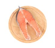 Raw salmon steak on cutting board. Isolated on a white background Royalty Free Stock Image