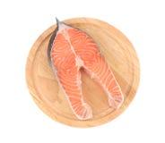 Raw salmon steak on cutting board. Royalty Free Stock Image