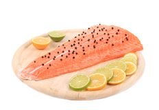 Raw salmon steak on cutting board. Isolated on a white background Stock Image