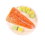 Raw salmon steak on cutting board. Royalty Free Stock Photos