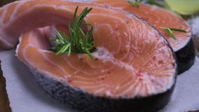 Raw salmon steak stock video