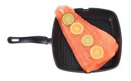 Raw salmon steak on frying pan. Stock Photos