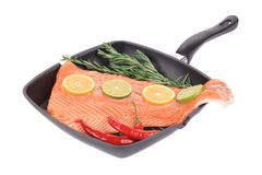 Raw salmon steak on frying pan. Royalty Free Stock Photos