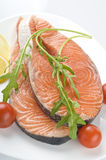 Raw salmon steak with herbs Stock Photo