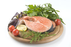 Raw salmon steak with herbs Royalty Free Stock Image