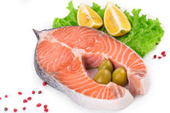 Raw salmon steak with lemon. Isolated on a white background Royalty Free Stock Image
