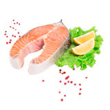 Raw salmon steak with lemon. Isolated on a white background Royalty Free Stock Images
