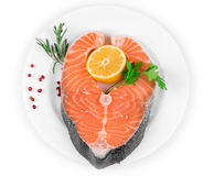 Raw salmon steak with lemon. Isolated on a white background Stock Images