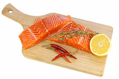 Raw salmon steak. With lemon and spices on a cutting board Royalty Free Stock Image