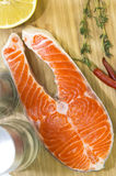 Raw salmon steak. With lemon and spices on a cutting board Royalty Free Stock Photo