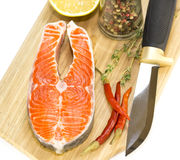 Raw salmon steak. With lemon and spices on a cutting board Stock Photos