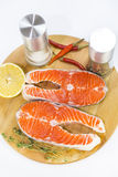 Raw salmon steak. With lemon and spices on a cutting board Royalty Free Stock Photos