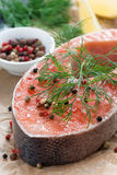 Raw salmon steak, lemon and spices prepared for cooking, closeup Royalty Free Stock Images