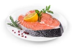 Raw salmon steak with lemon. Stock Photos