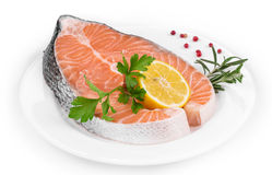 Raw salmon steak with lemon. Royalty Free Stock Image