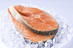 Raw salmon steak over ice Royalty Free Stock Images