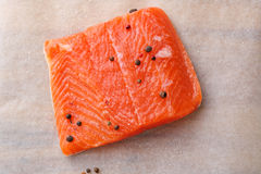 Raw salmon steak on paper Royalty Free Stock Images
