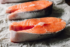 Raw Salmon Steak on Parchment Paper. Close up Royalty Free Stock Photos