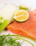 Raw salmon steak, preparation with lemon Stock Photos