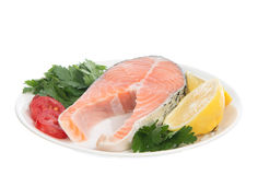 Raw salmon steak red fish on a plate Stock Photography