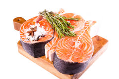 Raw salmon steak with rosemary Royalty Free Stock Images