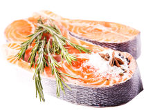 Raw salmon steak with rosemary Royalty Free Stock Photography