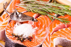 Raw salmon steak with rosemary on a bamboo board Stock Image