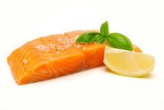 Raw salmon steak with seasoning royalty free stock image