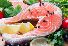 Raw salmon steak with vegetables Stock Image