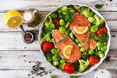 Raw salmon steak and vegetables. For cooking on a light wooden background in a rustic style. Top view Stock Image