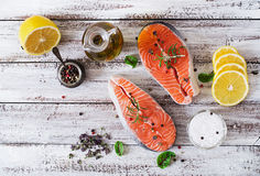Raw salmon steak and vegetables f. Or cooking on a light wooden background in a rustic style. Top view Royalty Free Stock Photo